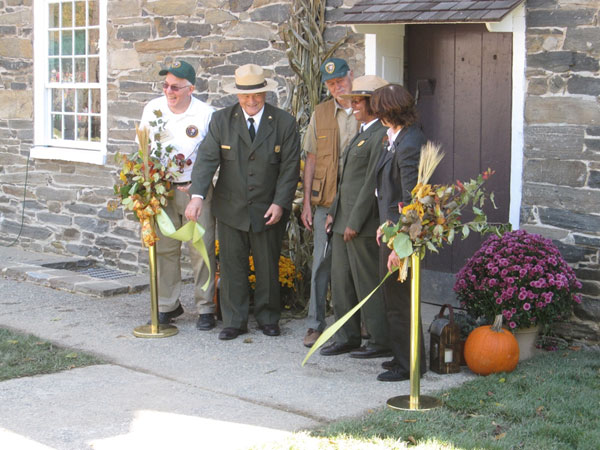 National Park Service and Friends of Peirce Mill representatives jointly cut the ribbon to officially mark the restart of mill operations in October 2011.