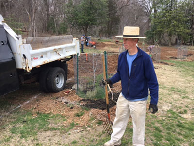 Tim Makepeace supervising delivery of mulch at the orchard.